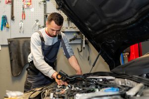 A,Professional,Car,Mechanic,Is,Changing,An,Air,Filter,,Doing