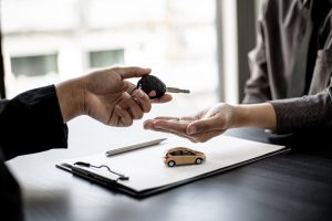 A,Car,Rental,Company,Employee,Is,Handing,Out,The,Car